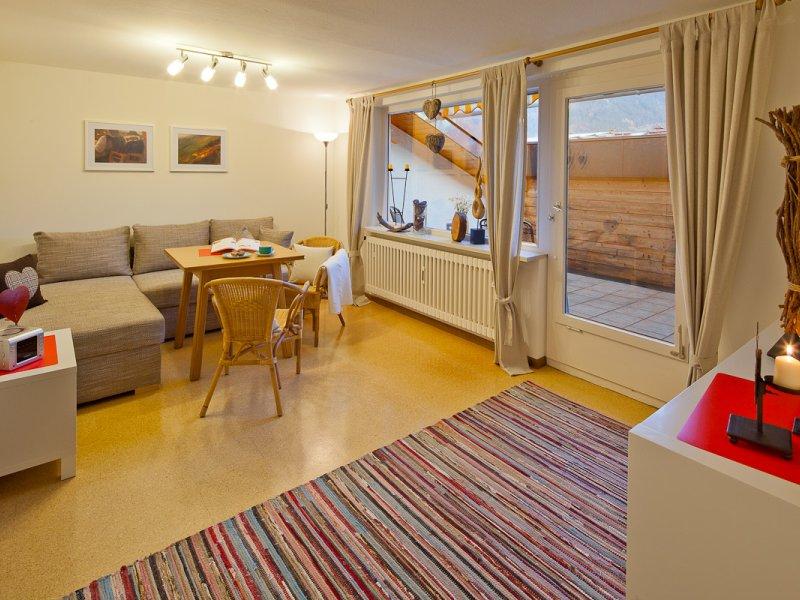 Wohnzimmer mit Dachterasse + Bergblick