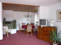 Fewo 2, Wohnzimmer mit Kachelofen