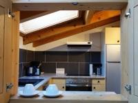 Ferienwohnung - Durchreiche Küche