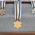 Medals are captured during the Cross Country Men 50KM Mass Start Classic medal ceremony